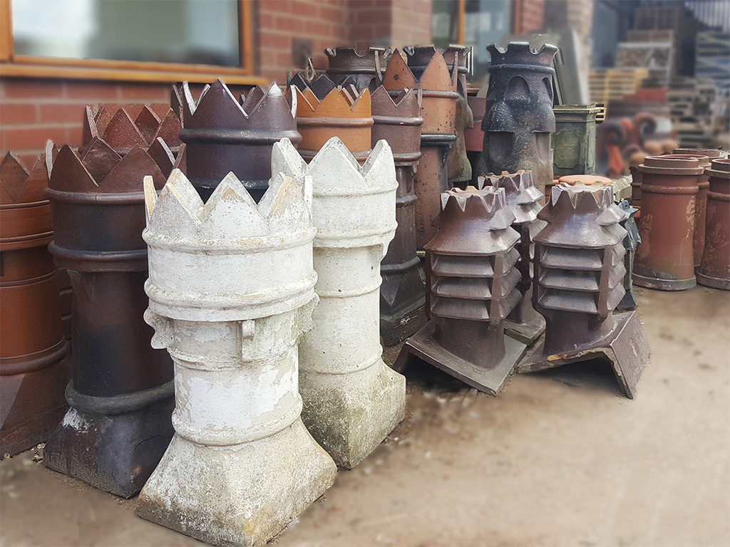 Collection of reclaimed chimney pots in reclamation yard