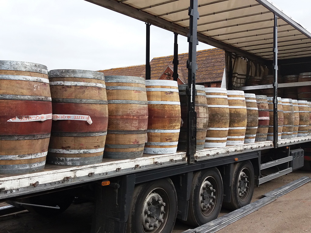 Reclaimed wooden oak barrels on vehicle
